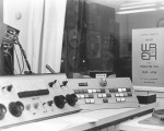 View over the main op board into the equipment room, where the automation gear was located. Circa 1971.